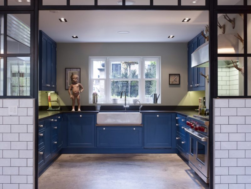 Industrial kitchen with navy cabinets and steel framed windows by Turner Pocock