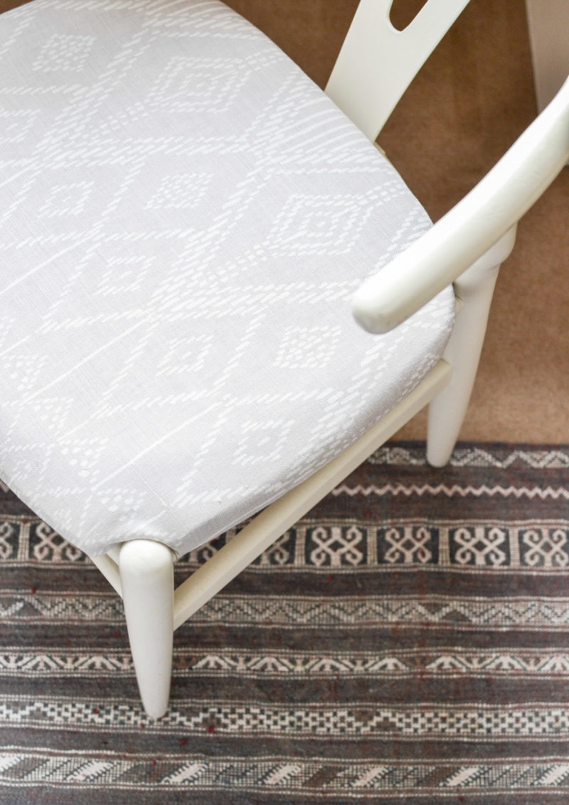 Global Neutral Master Bedroom Reveal - Wishbone Chair with Ikat Upholstery on Moroccan Rug