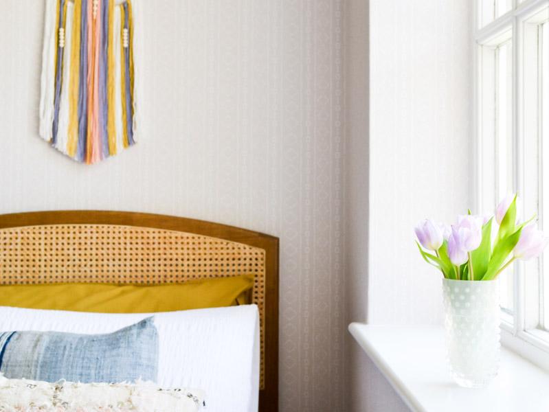Global boho kids bedroom makeover - wocker headboard + tulips