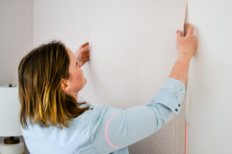 How to Hang Removable Wallpaper 6 - Use hands before Squeegee