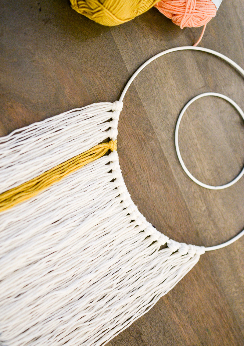Bottom row of yarn - How to Make a Wall Hanging with Wooden Beads DIY Tutorial