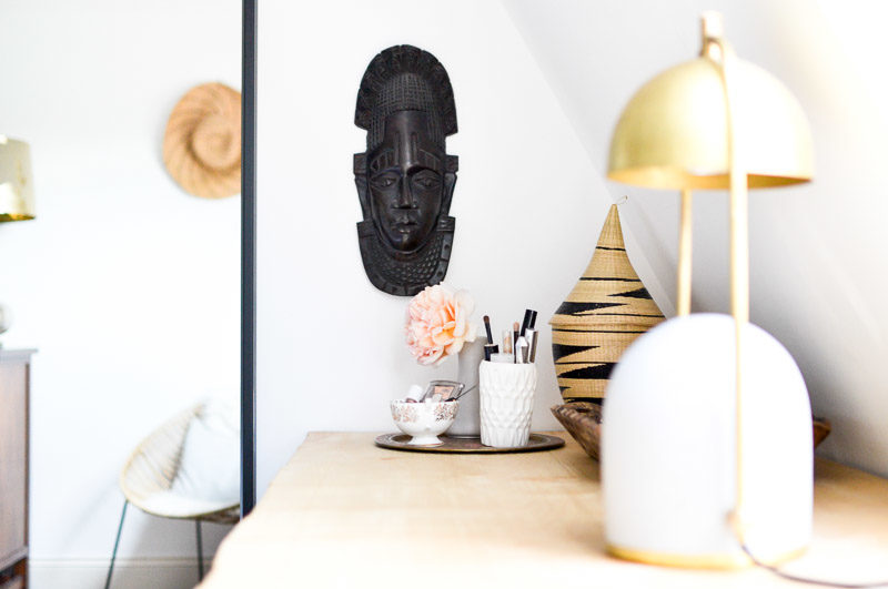 Desk styling with vanity tray and African wooden head